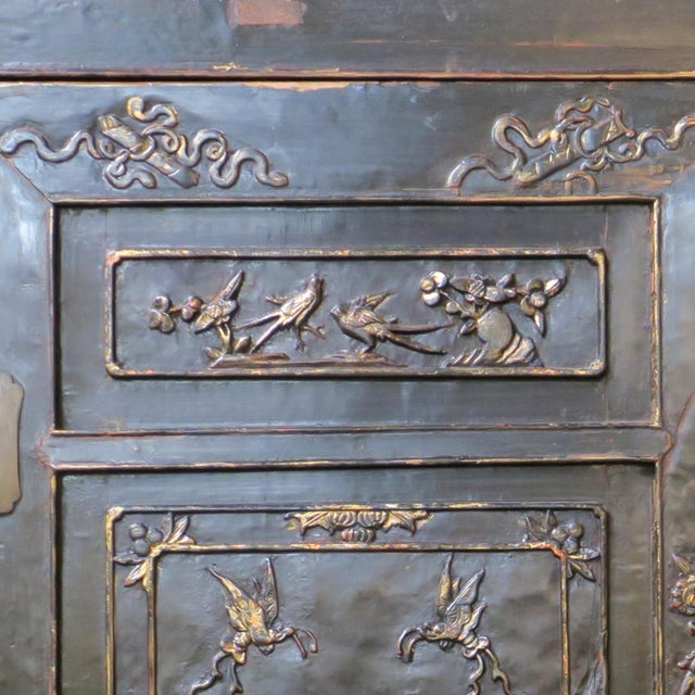 Antique Chinese Black Wedding Wardrobe Cabinet With Gold Carvings For Sale - Image 9 of 12