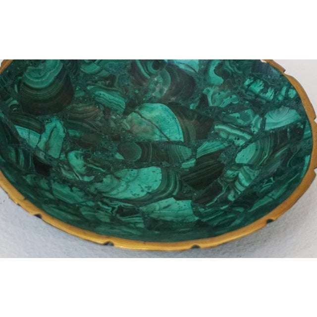 Small Malachite modern and sculptural bowl fashioned out of a piece of all natural malachite mineral stone. Malachite is a...