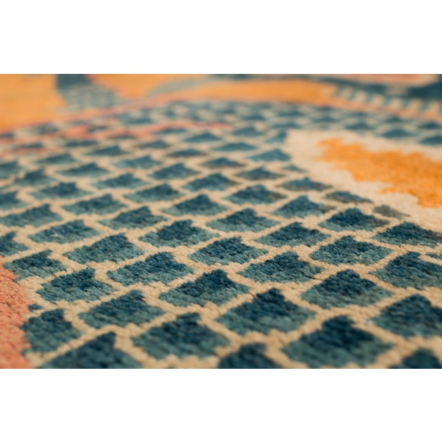 This piece is a fragmented rug and not complete. It is a Chinese pillar rug, probably woven for a Tibetan monastery. These...