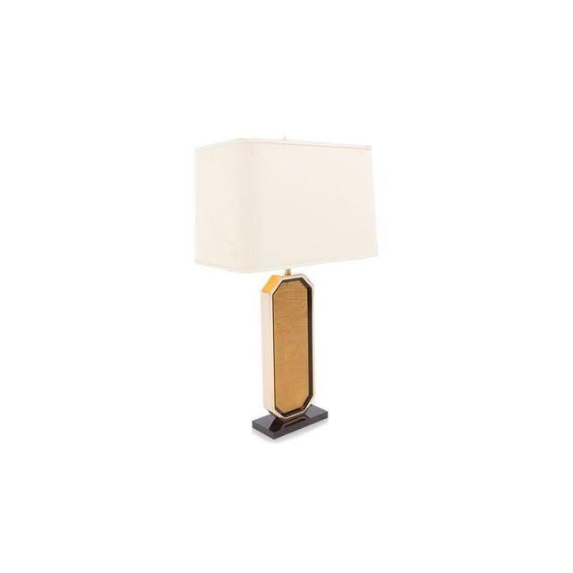 Hollywood regency table lamp 23-karat gold-plated. Brass etched artwork. Black glass. Black laminate base design Maho...
