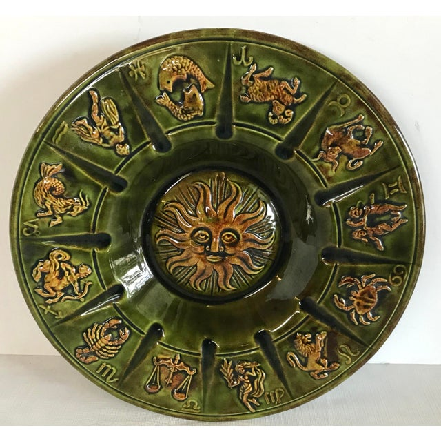This ceramic ashtray features all the zodiac signs in a mid century green and gold and could actually be hung on the wall...