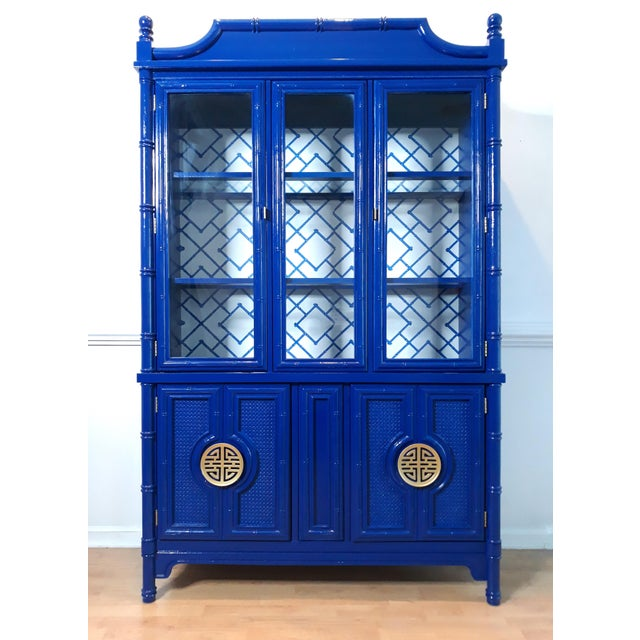 One of a kind faux bamboo and cane china cabinet or display case . The china cabinet has been lacquered in a glossy navy...