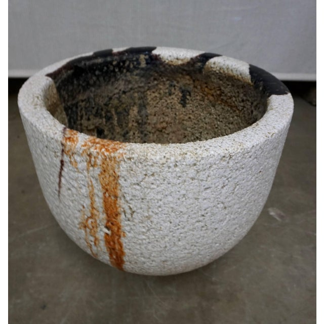 Ceramic vessel used to melt glass at very high temperatures. Enhanced by the crackling and the glass remnants and...