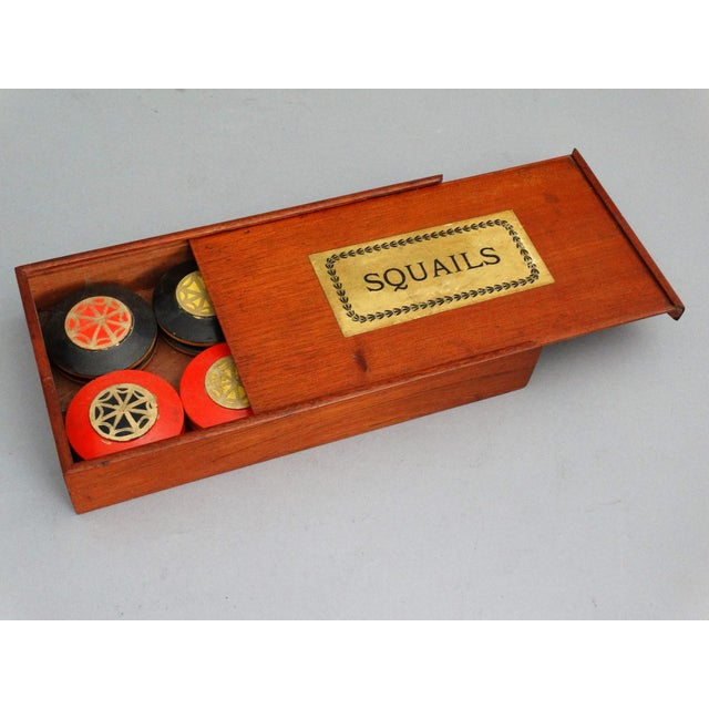 An English circa 1870, boxed mahogany squails game. It is all original, containing 16 discs, a procese and swoggle. This...