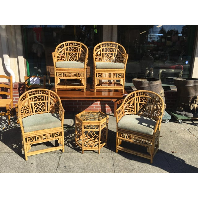 Wonderful patina on this set of four Chinese Chippendale chairs with open fretwork rising on 6 legs. Condition is...