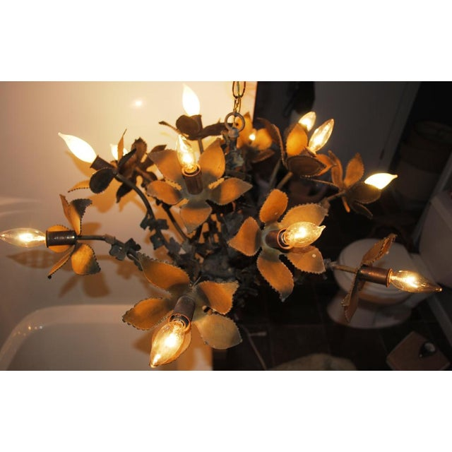 Mid-century brutalist flower chandelier by Feldman Co. of Los Angeles, CA. Attributed to Tom Greene, circa 1970's. Torch...