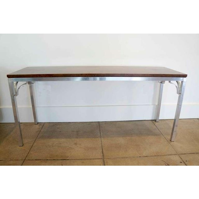 Walnut & Aluminum Console by Tomlinson NC. Solid. Beautifully polished aluminum frame with decotitive open corbel...