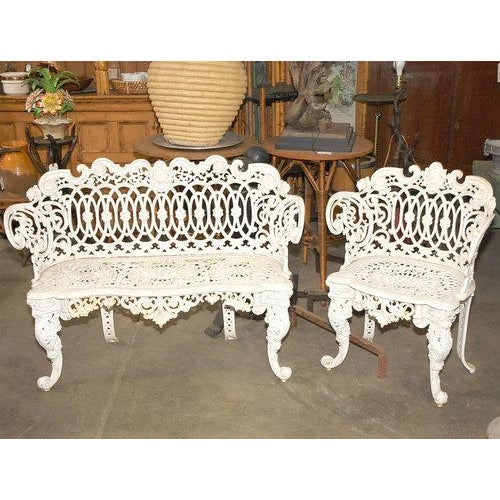 This Two Piece Garden Set In Cast Iron With Curved Forms Has Pierced Intertwining Face