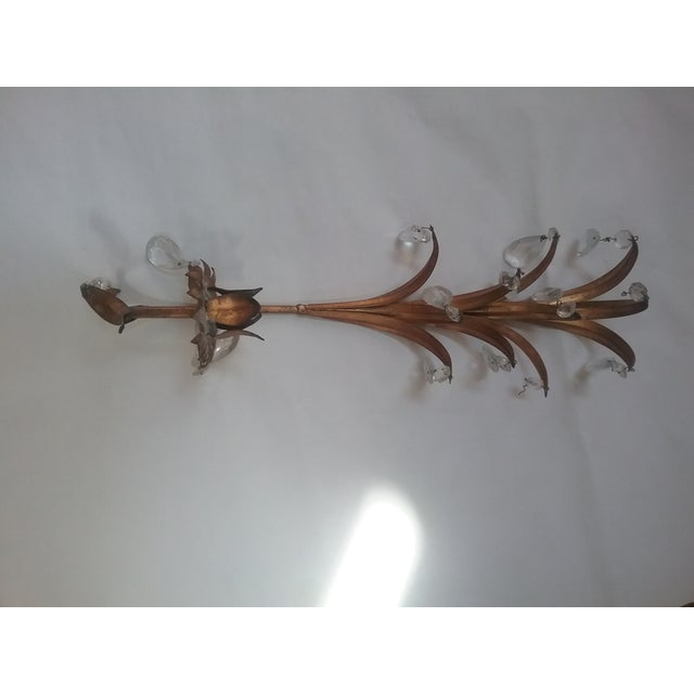Sweet Gilded Sconce Great details on this wall Sconce. Accented with glass prisms handing from the leaf/fronds. Easy mount