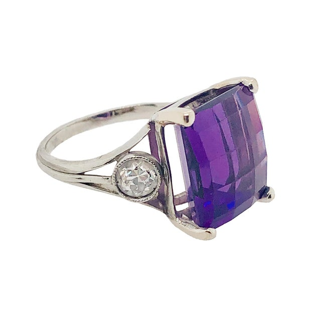 A fabulous vintage platinum ring featuring a fantasy cut rectangular amethyst. The amethyst has a nice deep color which...