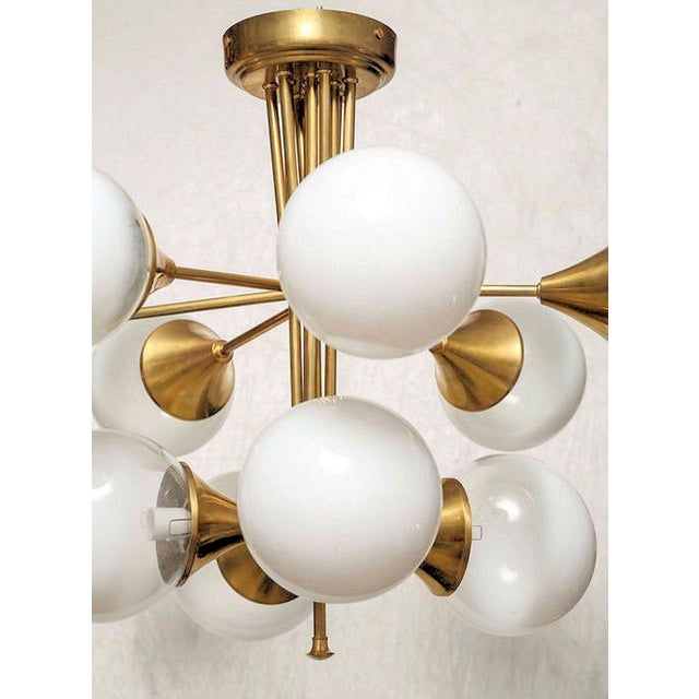 Brass and glass globes, 10 lights chandelier, attributed to Stilnovo, in style and quality. Mid Century Modern, Italy,...
