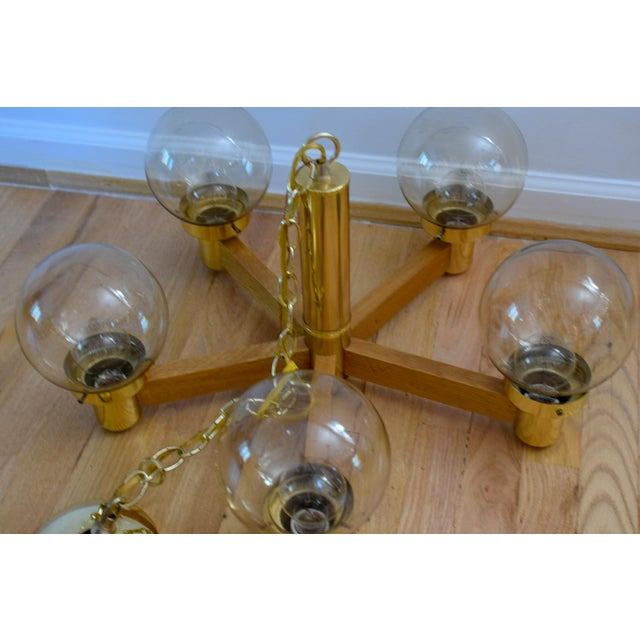 Mid Century 5 Arm Wood and Brass Chandelier With Globe Bulbs For Sale - Image 4 of 11