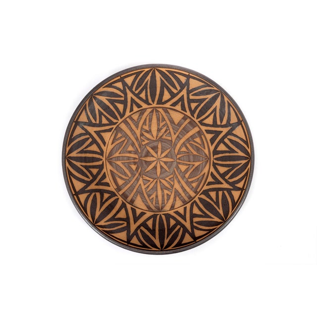 Clyde Burt ceramic platter in glazed stoneware with incised, abstract details. Signed to underside: [CB]. American, circa...