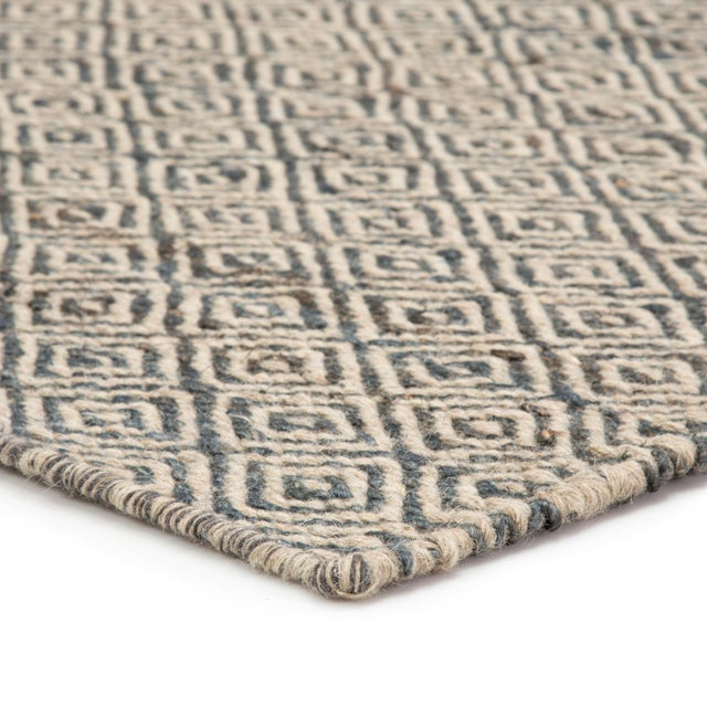 This natural flatweave area rug offers patterned panache and a durable construction to contemporary spaces. A chic diamond...