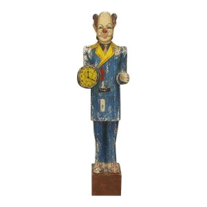 American Country style (mid 20th Cent) carved life-size wood figure of a circus side show clown holding a clock-face hat