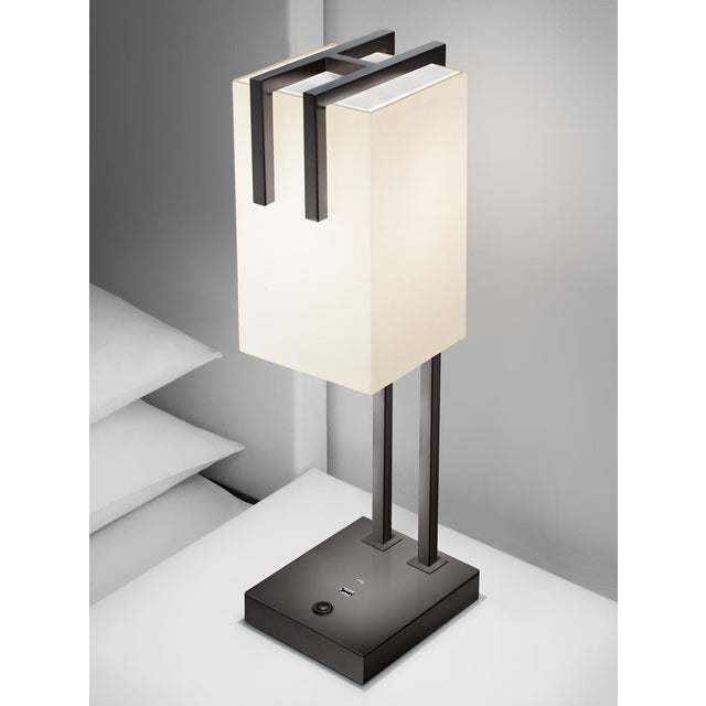 Black bronze double tube detail suspends a fabric shade which has an opal acrylic top diffuser. The base has a USB...