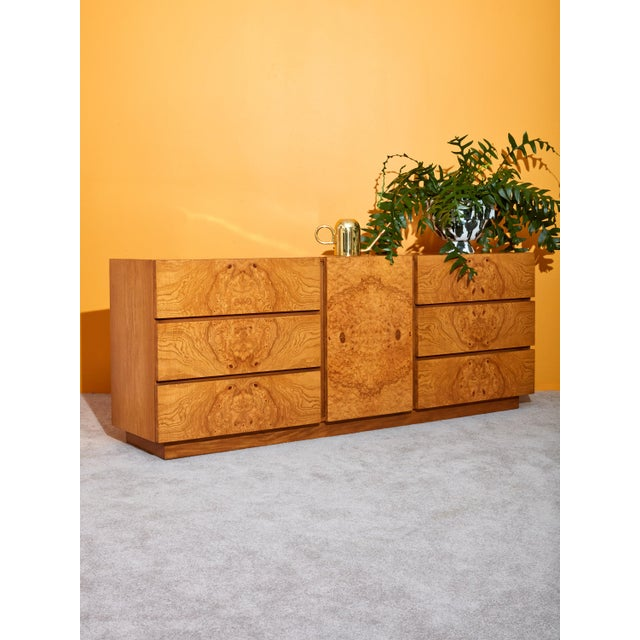 Vintage circa 1970s classic burl credenza designed by Milo Baughman for Lane Furniture. This sleek midcentury design...