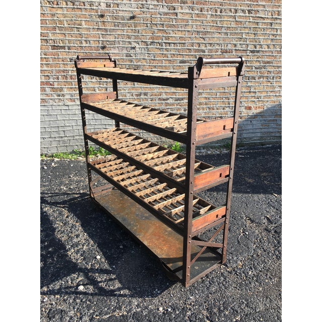 Rustic , well-used industrial-age shelving with iron frame and wood dowel shelves. Dramatic storage piece or wine rack....