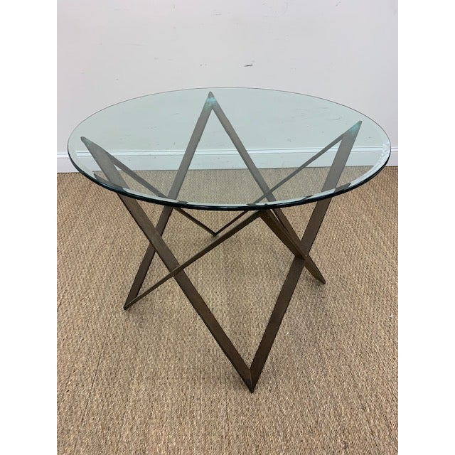 Great mid-century table base made from formed metal, in the shape of interlocking x's. Glass top not included. Perfect...