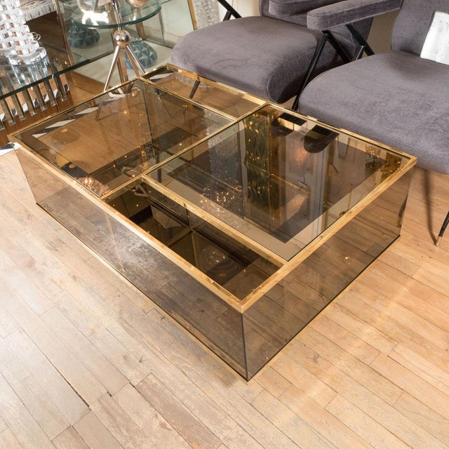 Rectangular brass and smoked glass compartment coffee table.