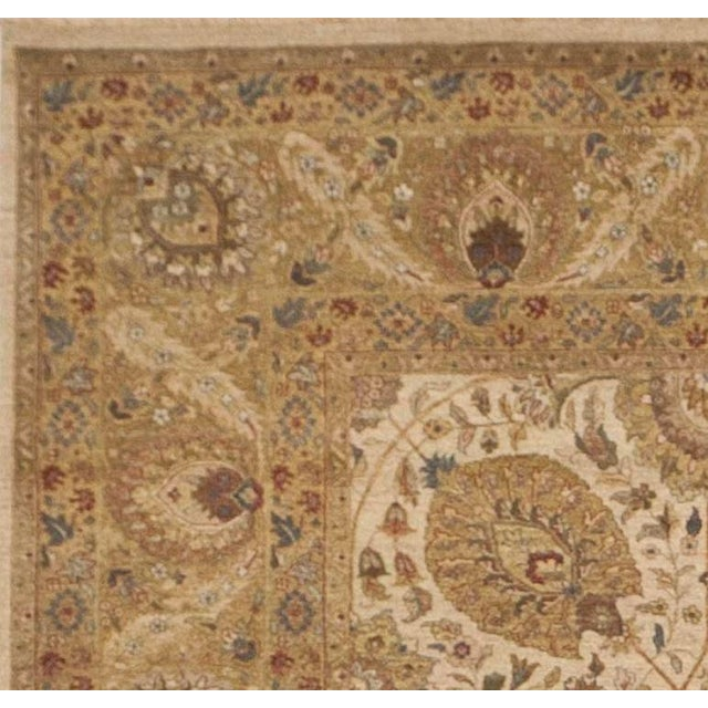 Antique revival. Haj Jalili style. Limited edition. Allover floral on beige background within gold border.