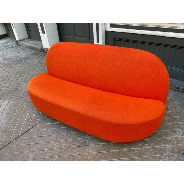 """Pierre Paulin """"Elysee"""" Loveseat in a Orange Nubby Fabric. Produced by Ligne Roset from the Paulin Archives. This Loveseat..."""