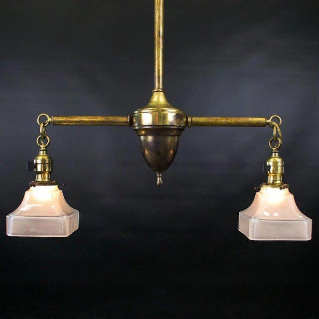 An exceptional period American Arts & Crafts two light fixture with original interior sand blasted glass shades. We have...