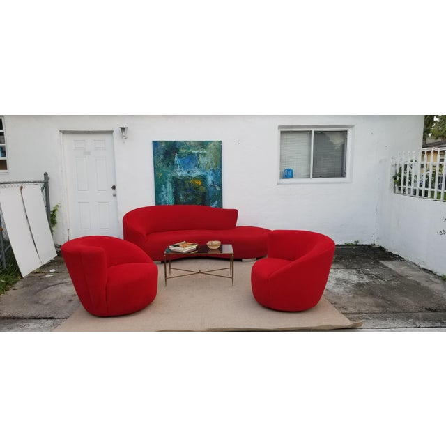 Mid-century modern iconic Vladimir Kagan design. This is a sculptural serpentine sofa in red velvet fabric and chrome...