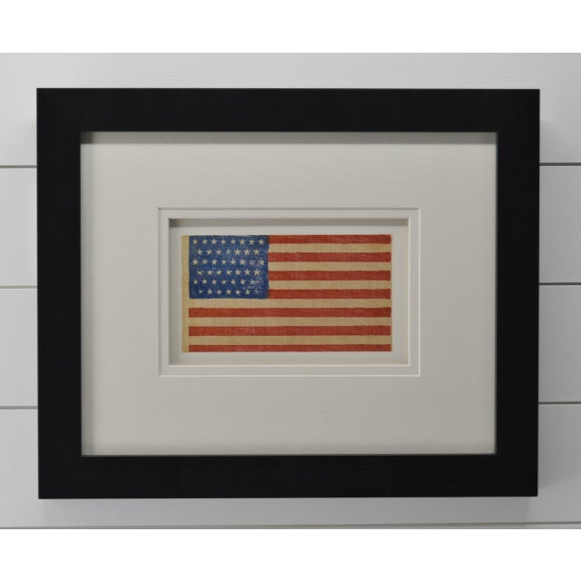 Authentic antique 45 Star American Flag with museum framing and UV acrylic. Made of starched gauze material. Circa 1896,...