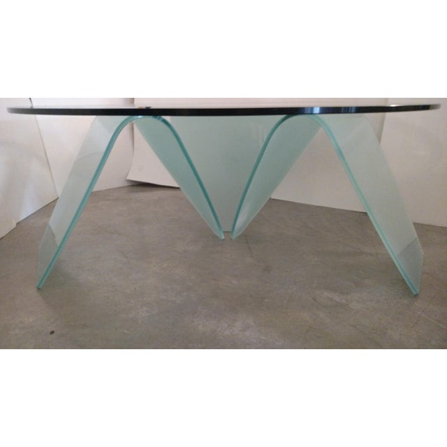 This a beautiful, graceful beveled glass cocktail table with a 3 piece frosted and bent glass base. The entire table has a...
