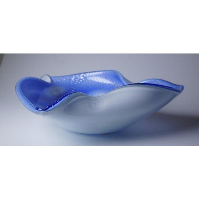 Triangular blue bowl with silver flecks.