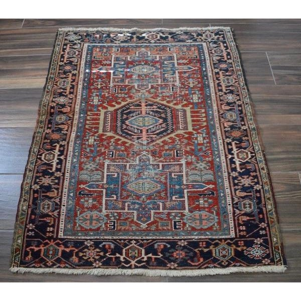 Antique Shabby Chic small Heriz rug featuring a triple medallion geometric pattern. Palette includes: madder red, navy,...