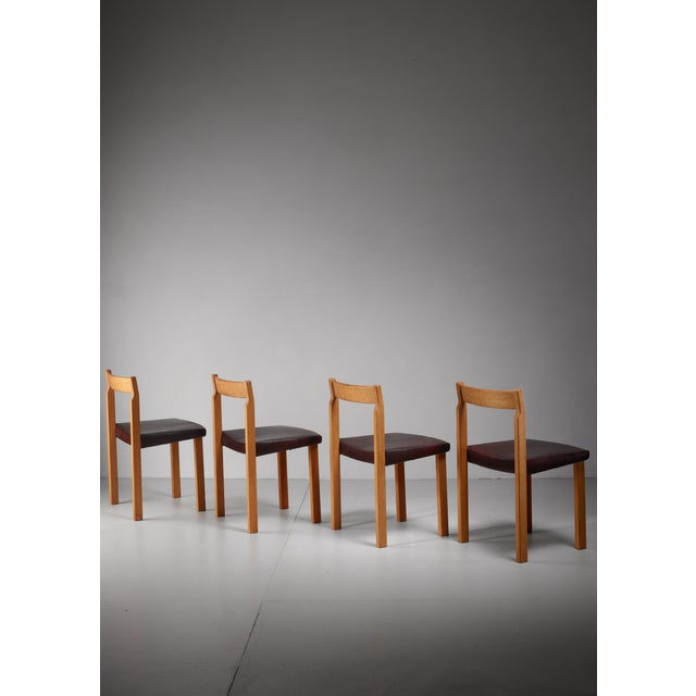 A set of four dining chairs by Olavi Hänninen for Huonekalu Mikko Nupponen. These model 'Tuomas' chairs are made of oak...