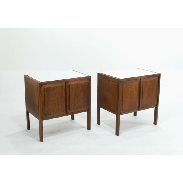 Made of solid walnut and finished with a white laminate top; these Jack Cartwright for Founders nightstands are in...