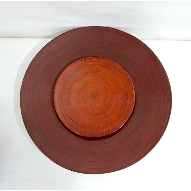 Vintage set of lacquered Burmese red/burnt orange 'spiral' bamboo plates with matching charger. These have been made by...