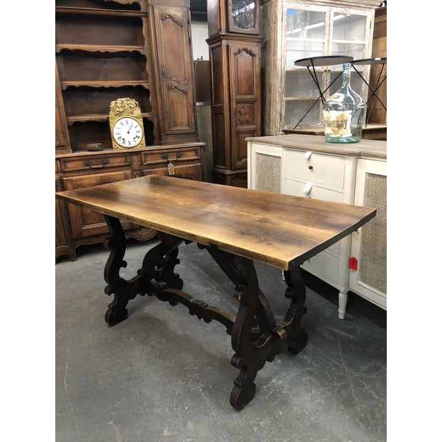 Circa 1870's Italian Renaissance Trestle table in walnut. Scrolled base and stretchers. Versatile table, could be used as...