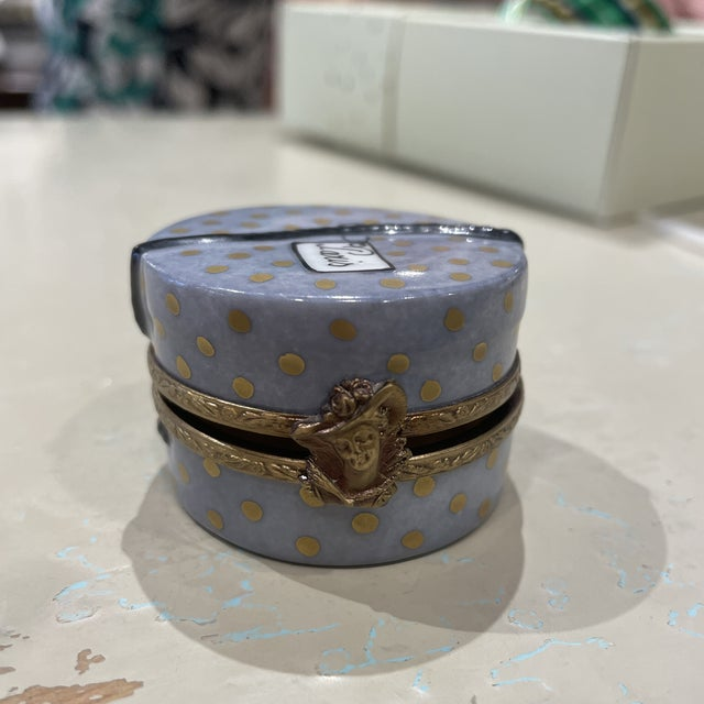 This is a lovely Limoges trinket box. It opens to store small objects, like jewelry, coins or whatever you'd like. This...