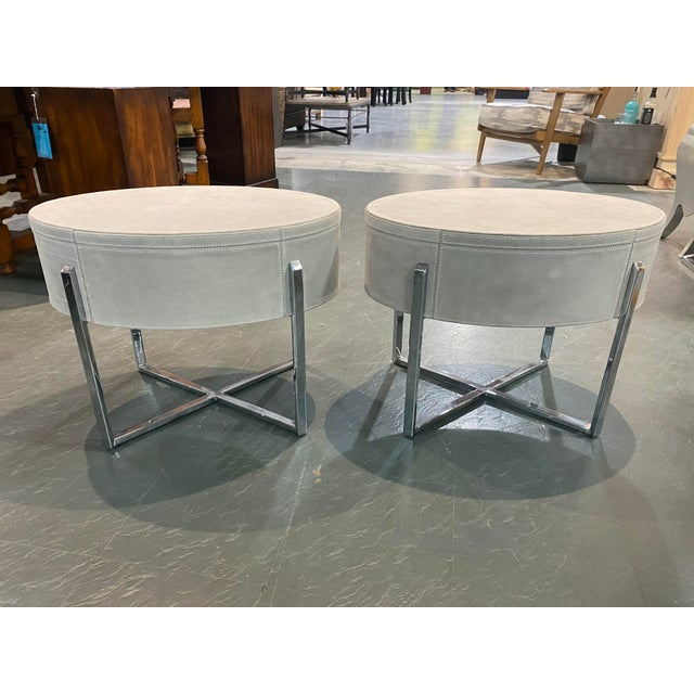 A beautiful matching pair of suede end tables with very cool push front drawer and stainless steel frame. I'm excellent...