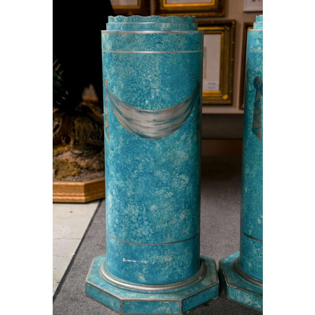 Possibly plaster, each of these two cylindrical pedestals has a circular top. There is overall distress painted blue with...