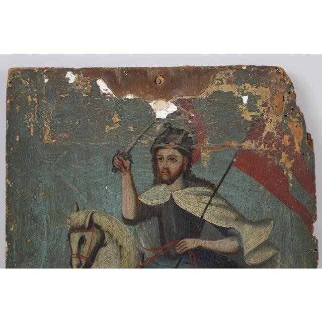 "Rare 18th century Spanish Colonial folk retablo on wood panel of Santiago Matamoros, ""St James the Moorslayer,"" riding his..."
