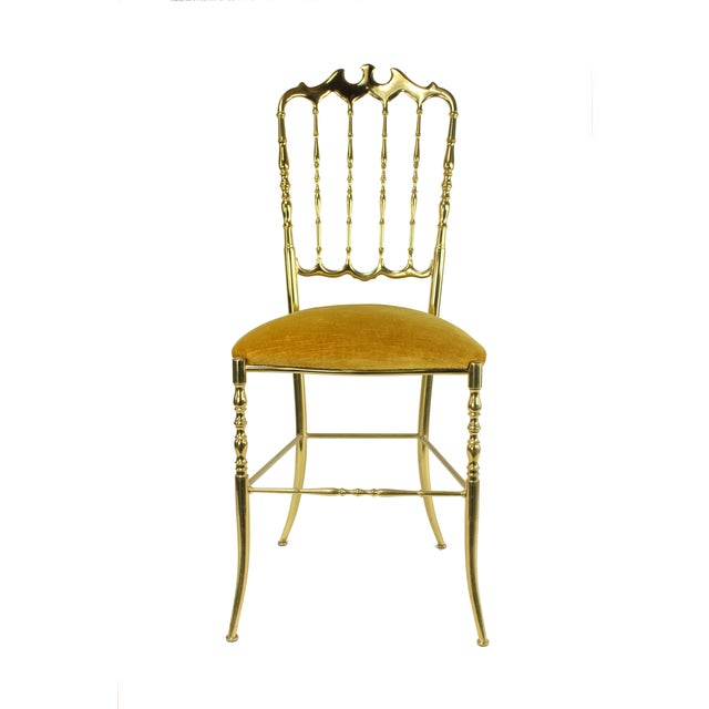 A late 1950's ornate vanity chair made in Italy by Chiavari in it's pristine original gold velveteen fabric. This piece is...