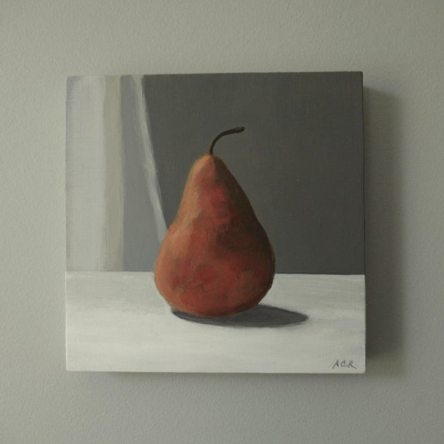 Pear on a white table cloth. Finding the beauty in a single piece of fruit with a dutch influence. This painting is...
