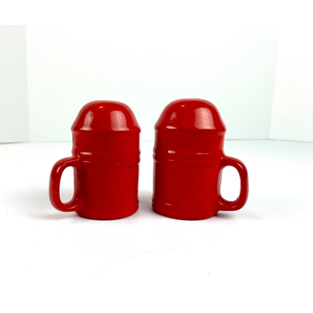 Fire engine red, glazed ceramic, industrial modern salt & pepper shaker set, c. mid 20th century. Why we love it; we are...