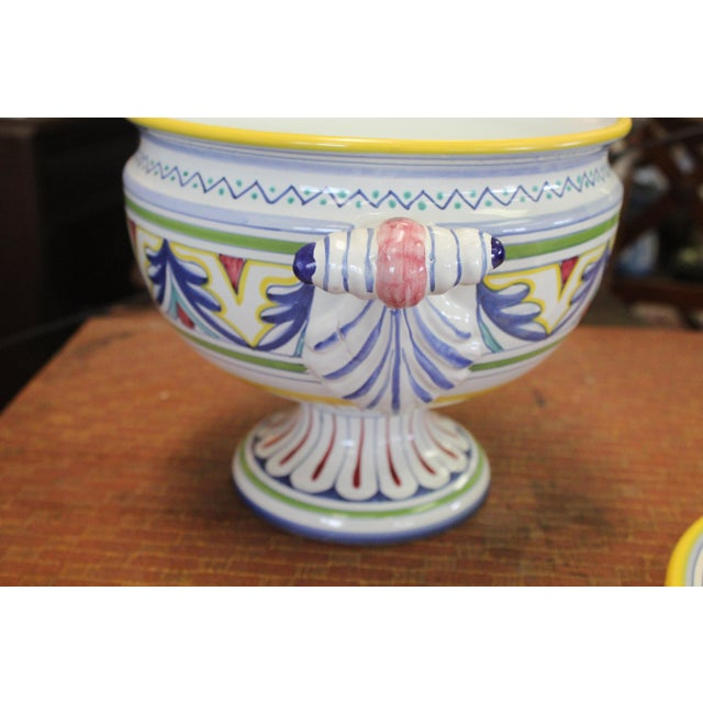 Hand painted Italian soup tureen in white porcelain with colorful details.