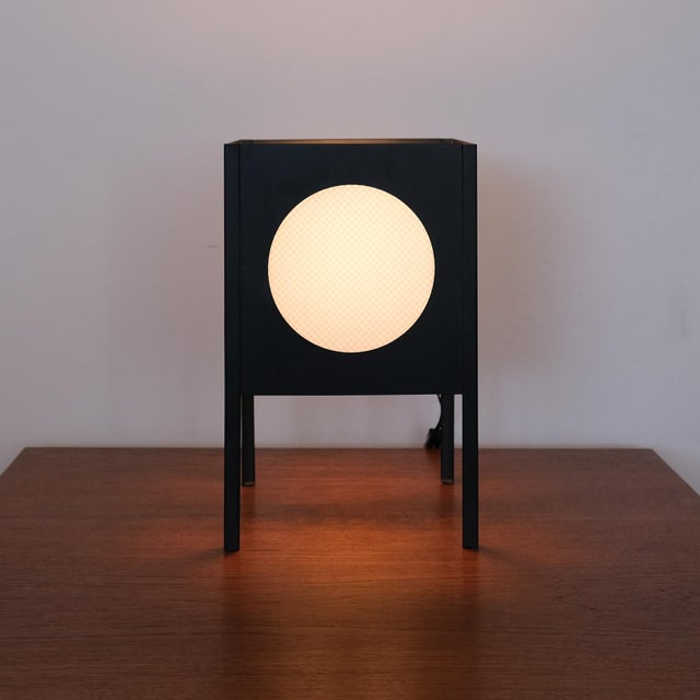 Metal cube lamp with four circular cutouts with removable plastic inserts. USA, 1960s.