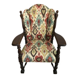 Early 20th Century Ikat Fabric Upholstered Wingback Armchair For Sale