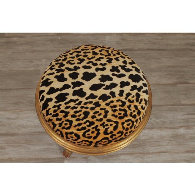"""Charles X style giltwood leopard upholstered stool 20th century. Dimensions:19"""" height x 21"""" diameter."""