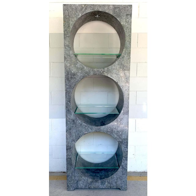 """Modern tessellated stone monolithic bookcase/ vitrine by Marquis Collection of Beverly Hills, fitted with three 25""""..."""