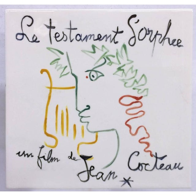 Vintage 1960s movie poster transcribed on a ceramic white tile in reference to the French Film by Jean Cocteau.