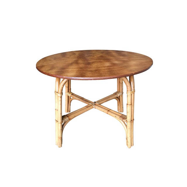 "Round rattan coffee Table with oak top and two strand ""X"" arched table base. Designed in the manner of Paul Frankl...."